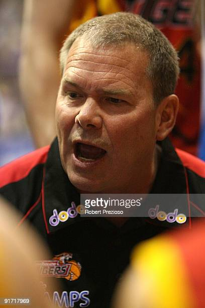 Coach Alan Westover of the Tigers talks to his players during the round three NBL match between the Melbourne Tigers and the Townsville Crocodiles on...