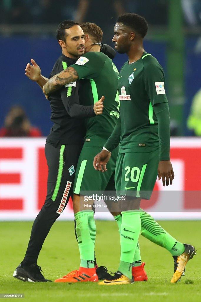Coach Alexander Nouri of Bremen (l) embraces Robert Bauer of Bremen while Ulisses Garcia of Bremen walks by after the Bundesliga match between Hamburger SV and SV Werder Bremen at Volksparkstadion on September 30, 2017 in Hamburg, Germany.