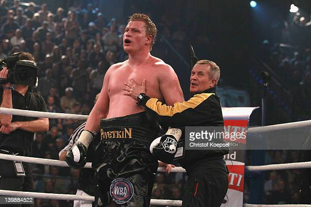 Coach Alexander Zimin controls Alexander Povetkin of Russia during the WBA World Championship Heavyweight fight between Marco Huck of Germany and...