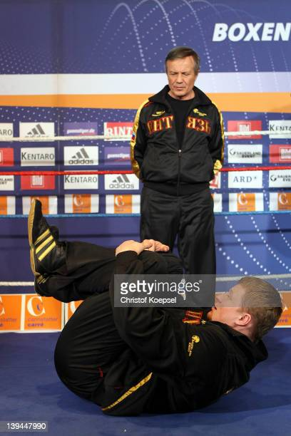 Coach Alexander Zimin watches Alexander Povetkin of Russia boxes during the public training at Canstatter Carre on February 21 2012 in Stuttgart...