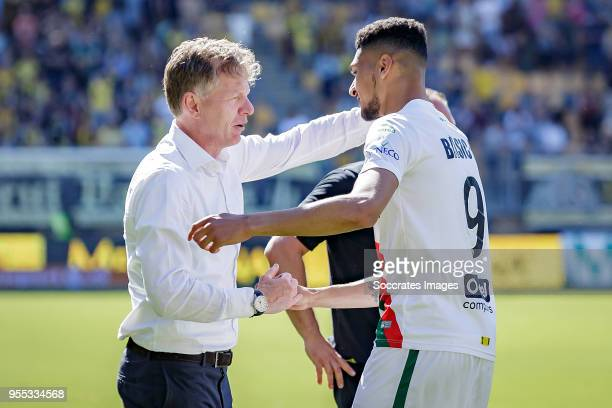 coach Alfons Groenendijk of ADO Den Haag Bjorn Johnsen of ADO Den Haag celebrate the victory and the qualification for the Play Offs during the Dutch...