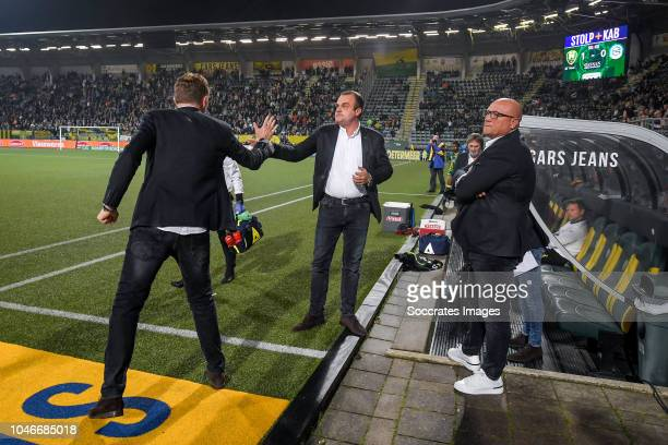coach Alfons Groenendijk of ADO Den Haag goalkeeper coach Raymond Mulder of ADO Den haag celebrates the victory during the Dutch Eredivisie match...
