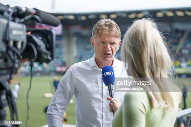 coach Alfons Groenendijk of ADO Den Haag talking to Helene Hendriks of FOX Sports during the Dutch Eredivisie match between ADO Den Haag v FC Emmen...
