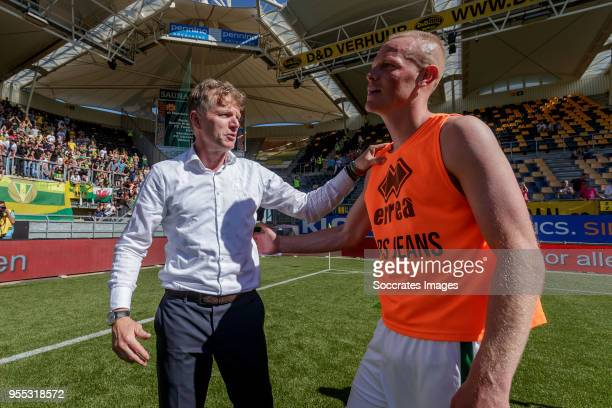 coach Alfons Groenendijk of ADO Den Haag Tom Beugelsdijk of ADO Den Haag celebrate the victory and the qualification for the Play Offs during the...