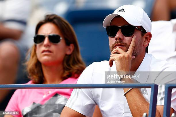 Coach Amelie Mauresmo and Daniel Vallverdu watch Andy Murray of Great Britain play against JoWilfried Tsonga of France during their men's singles...