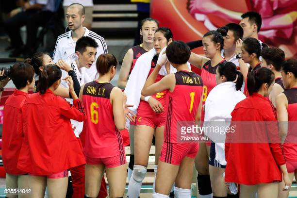 Coach An Jiajie of China talks to the team during 2017 Nanjing FIVB World Grand Prix Finals between China and Brazil on August 2 2017 at Nanjing...
