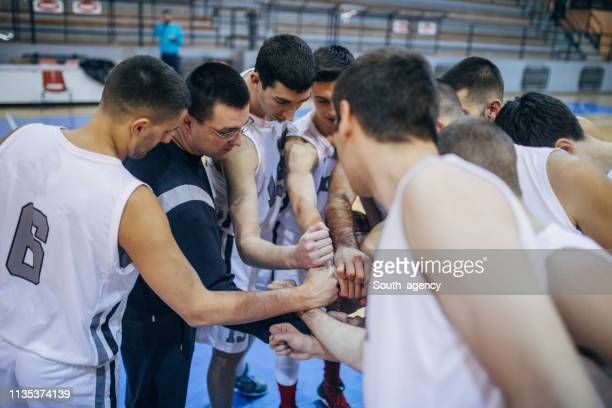 coach and basketball players - pep talk stock pictures, royalty-free photos & images