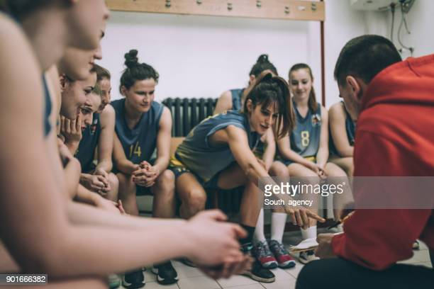 coach and female basketball players - pep talk stock pictures, royalty-free photos & images