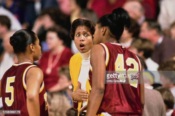 Coach and former player of the USC Trojans, women's basketball team, Cheryl Miller, gives instructions during a game against Stanford Cardinal at...