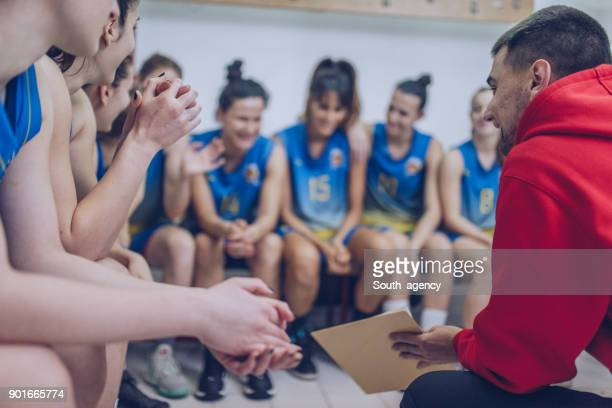 coach and group of basketball players - pep talk stock pictures, royalty-free photos & images