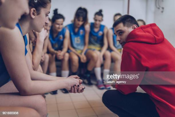 coach and group of female players - pep talk stock pictures, royalty-free photos & images