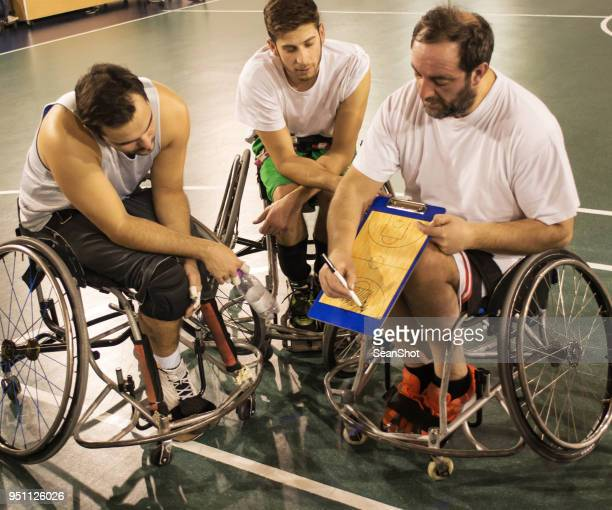 coach and his disabled basketball player team - paraplegic stock photos and pictures