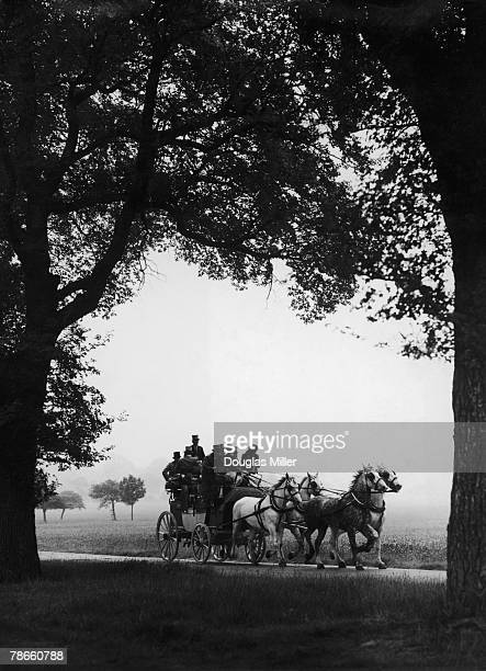 A coach and horses crosses Richmond Great Park London on its way to the take part in the coaching marathon at Richmond Horse Show 12th June 1948