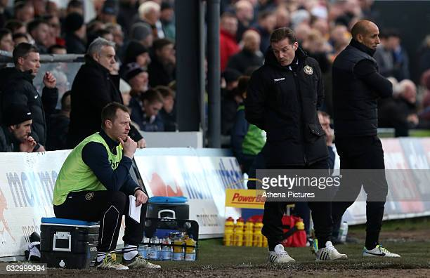 Coach and player Michael Flynn talks with Graham Westley of Newport County AFC during the Sky Bet League Two match between Newport County and...