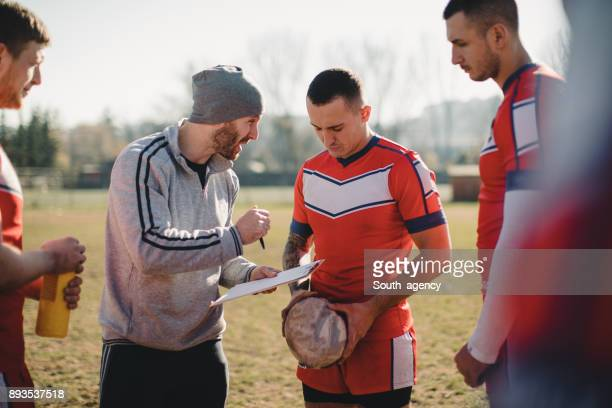 coach and players - pep talk stock pictures, royalty-free photos & images
