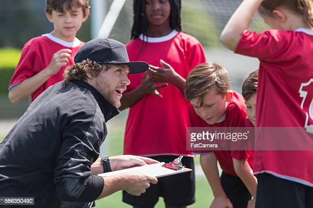 coach and soccer players - coach stock pictures, royalty-free photos & images