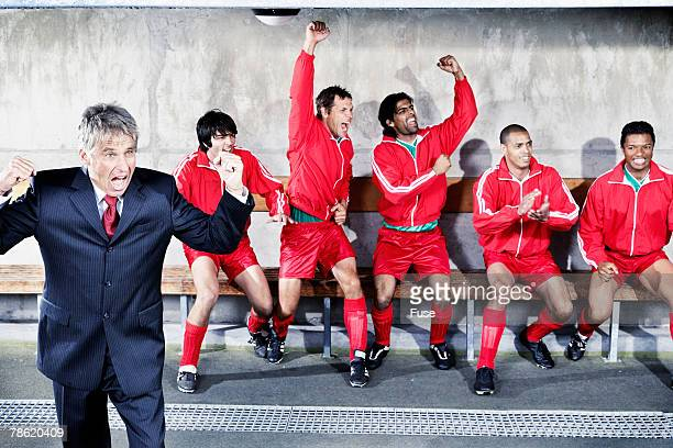 coach and soccer team on bench cheering - football team stock pictures, royalty-free photos & images