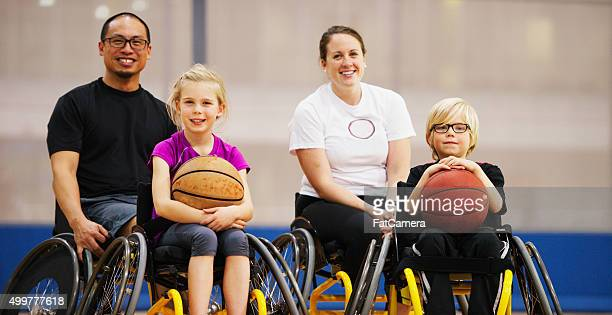 Coach and Students Sitting Happily in Their Wheelchairs