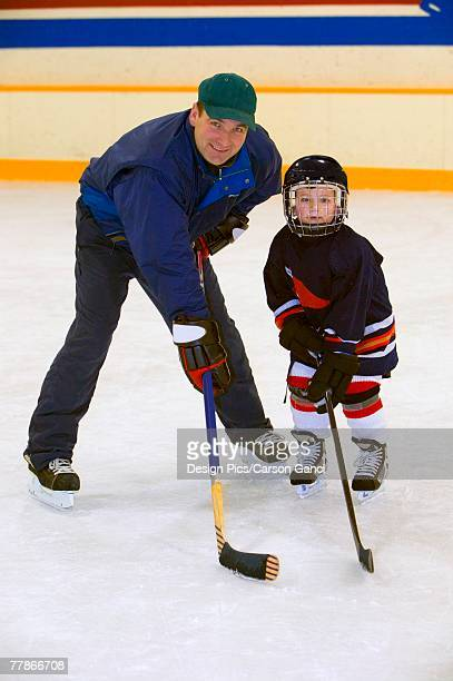 a coach and young hockey player - ice hockey rink stock pictures, royalty-free photos & images