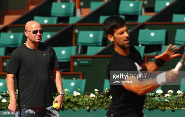 Coach Andre Agassi watches on during a Novak Djokovic training session prior to his match against Marcel Granollers of Spain on day two of the 2017...