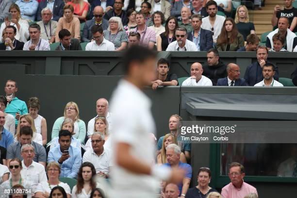 Coach Andre Agassi watching Novak Djokovic of Serbia in action against Adrian Mannarino of France in the Gentlemen's Singles round of sixteen at the...