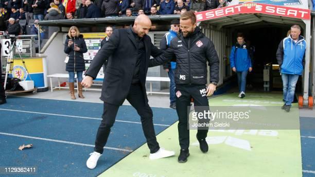 Coach Andre Schubert of Braunschweig and Coach Michael Schiele of Wuerzburg before the 3. Liga match between Eintracht Braunschweig and FC...