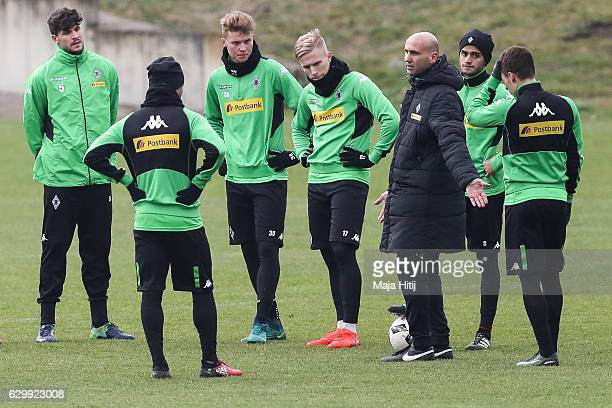 Coach Andre Schubert of Moenchengladbach talks to the players during a training session on December 15, 2016 in Moenchengladbach, Germany.