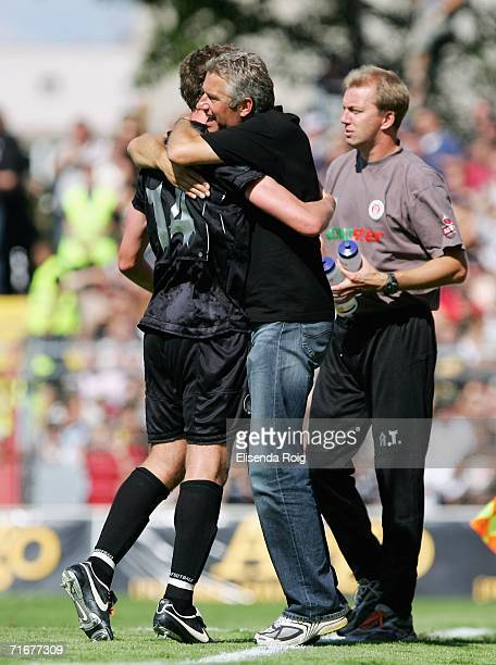 Coach Andreas Bergmann of Pauli celebrates the first goal with Marcel Eger of Pauli during the Third League match between FC StPauli and Werder...