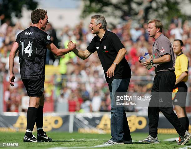 Coach Andreas Bergmann of Pauli shakes hands with Marcel Eger of Pauli during the Third League match between FC StPauli and Werder Bremen II at the...