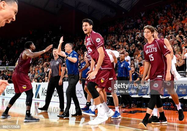 Coach Andrej Lemanis of the Bullets and his players celebrate victory after the round 10 NBL match between the Cairns Taipans and the Brisbane...