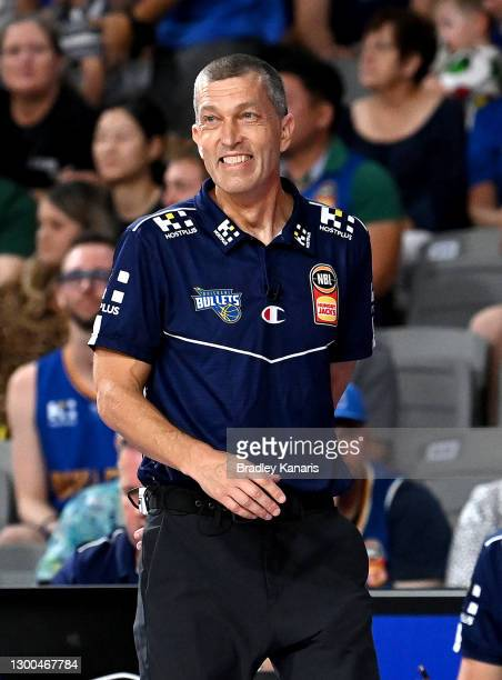 Coach Andrej Lemanis of the Bullets smiles as he watches on during the round four NBL match between the Brisbane Bullets and Melbourne United at...