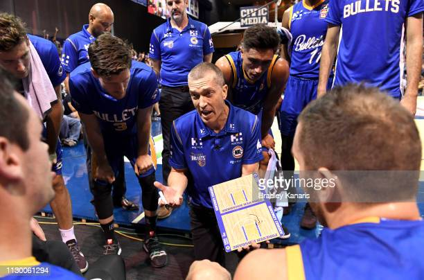 Coach Andrej Lemanis of the Bullets talk to his players at the timeout during the round 18 NBL match between the Brisbane Bullets and the New Zealand...
