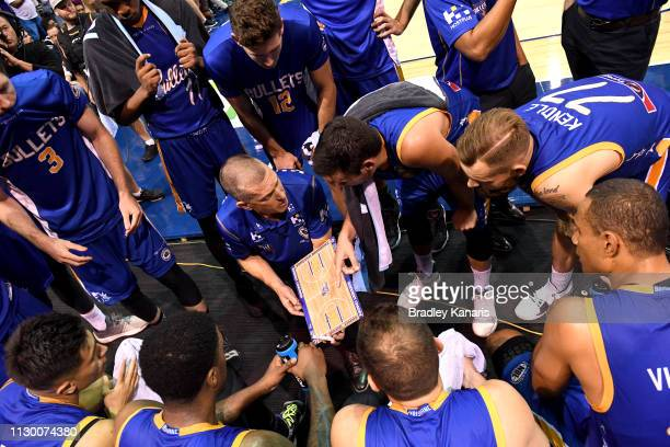 Coach Andrej Lemanis of the Bullets talks tactics to his players at the timeout during the round 18 NBL match between the Brisbane Bullets and the...