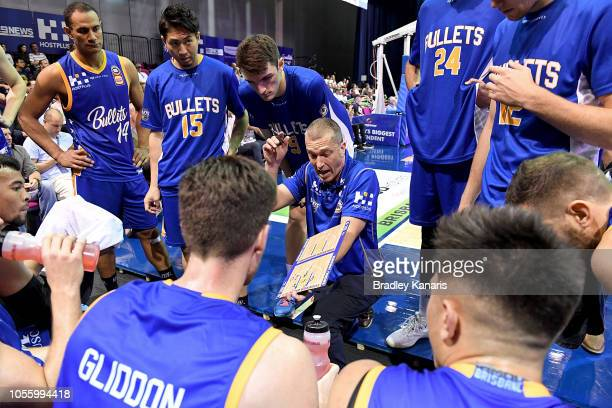 Coach Andrej Lemanis of the Bullets talks to his player at a timeout during the round four NBL match between the Brisbane Bullets and the Adelaide...