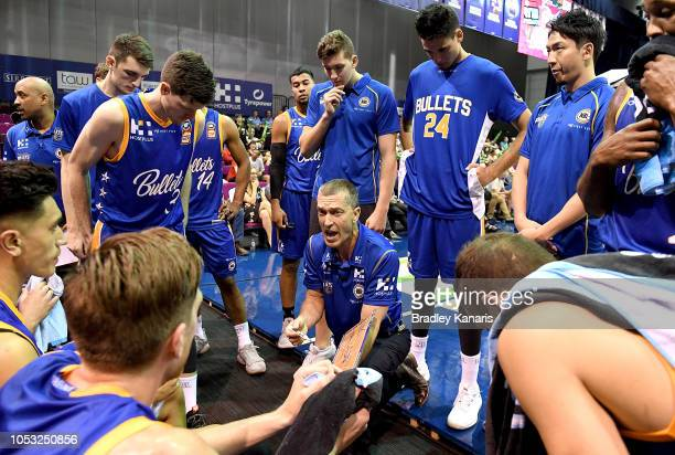Coach Andrej Lemanis of the Bullets talks to his players at a timeout during the round three NBL match between the Brisbane Bullets and the Perth...