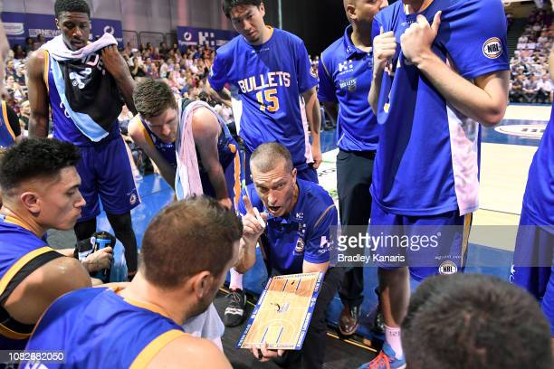 Coach Andrej Lemanis of the Bullets talks to his players at a timeout during the round nine NBL match between the Brisbane Bullets and the Adelaide...
