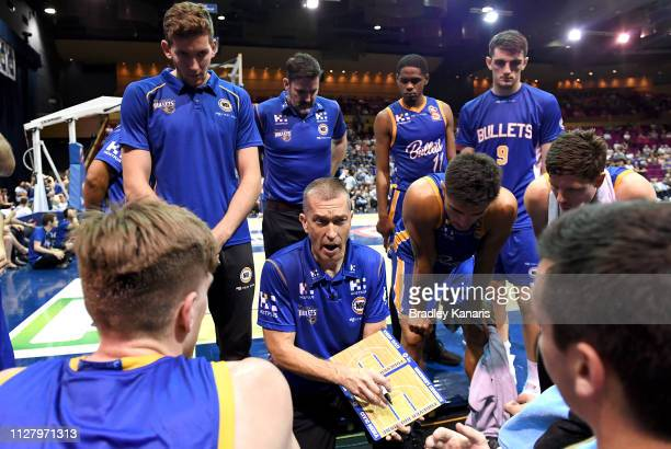 Coach Andrej Lemanis of the Bullets talks to his players at the timeout during the round 17 NBL match between the Brisbane Bullets and the Illawarra...