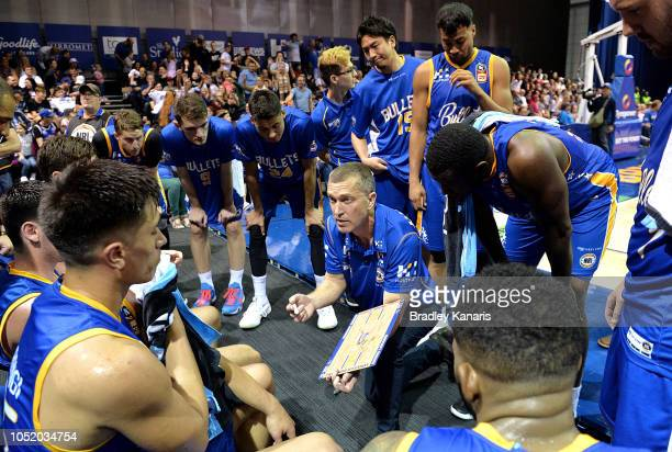 Coach Andrej Lemanis of the Bullets talks to his players during a timeout at the round one NBL match between the Brisbane Bullets and the Cairns...
