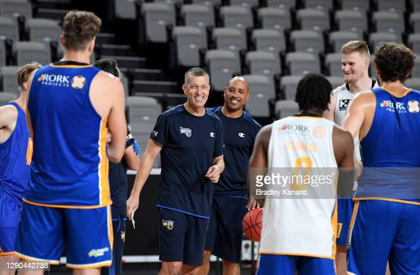 Coach Andrej Lemanis shares a laugh with his players during a Brisbane Bullets NBL training session at the Nissan Arena on December 10, 2020 in...
