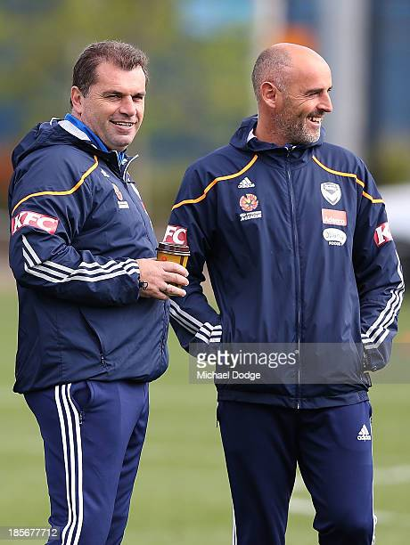 Coach Ange Postecoglou and assistant coach Kevin Muscat react during a Melbourne Victory ALeague training session at Gosch's Paddock on October 24...