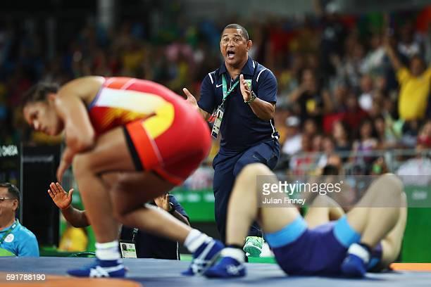 Coach Angel Aldama celebrates after Aline da Silva Ferreira of Brazil defeats Rio Watari of Japan during the Women's Freestyle 75 kg 1/8 Finals on...