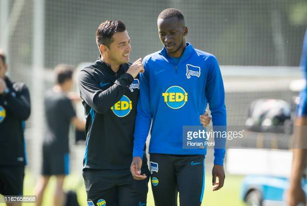 Coach Ante Covic and Dodi Lukebakio of Hertha BSC chat after the Training on august 19 2019 in Berlin Germany
