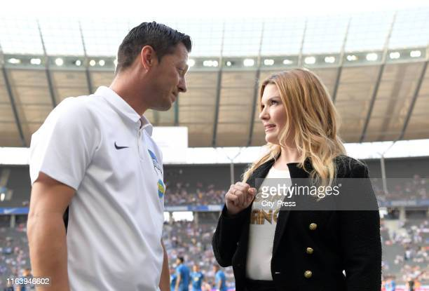 Coach Ante Covic of Hertha BSC SKY Sport anchorwoman Jessica Kastrop before the game between Hertha BSC against VfL Wolfsburg on August 25, 2019 in...