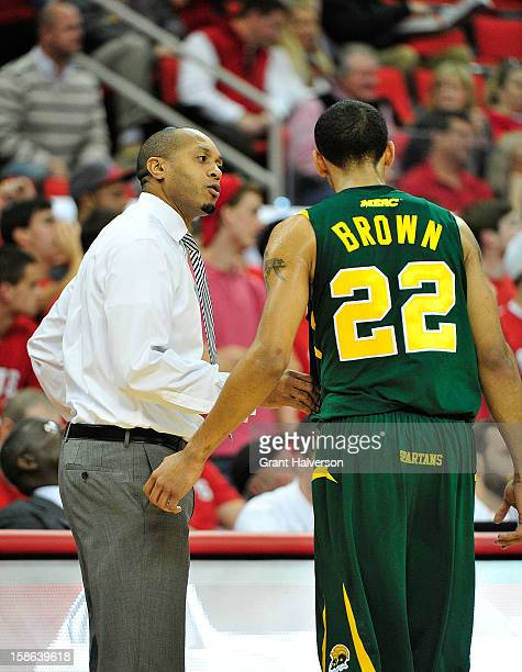 Coach Anthony Evans talks with Kris Brown of the Norfolk State Spartans against the North Carolina State Wolfpack at PNC Arena on December 15 2012 in...