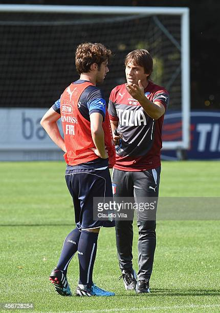 Coach Antonio Conte and Andrea Poli during Italy Training Session at Coverciano on October 6 2014 in Florence Italy