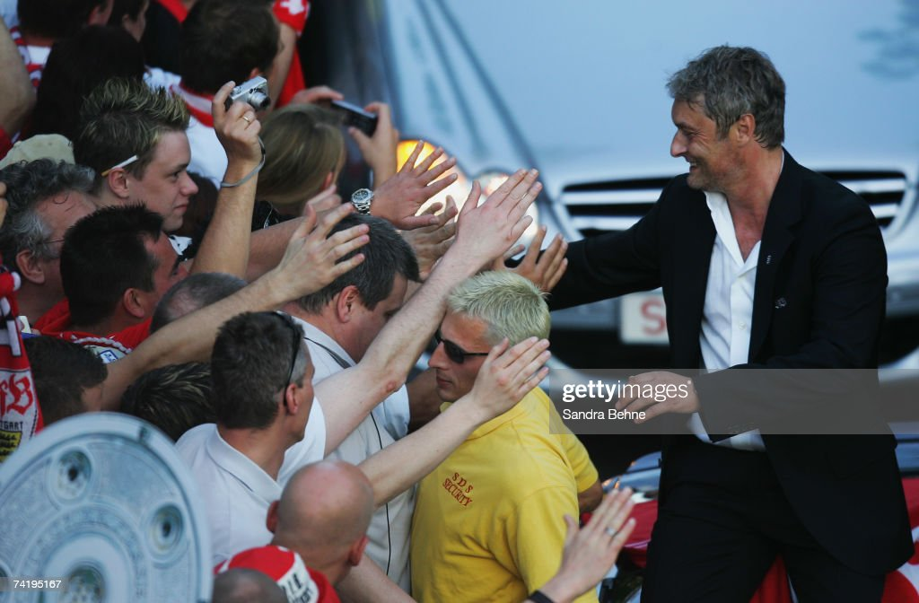 Coach Armin Veh of VfB Stuttgart shakes hands with fans during a car convoy after winning the German championships after the Bundesliga match against Energie Cottbus at the Gottlieb-Daimler stadium on May 19, 2007 in Stuttgart, Germany.