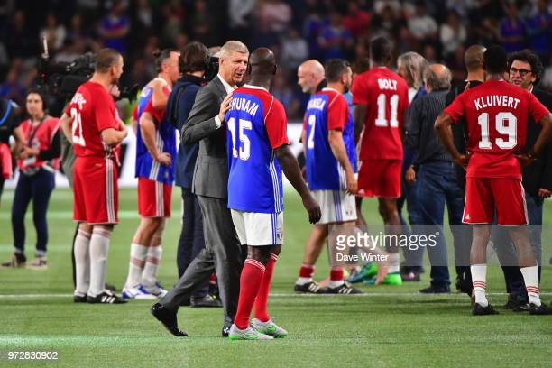 FIFA98 coach Arsene Wenger and Lilian Thuram of France following the Legends Game match between France 98 and Fifa 98 at U Arena on June 12 2018 in...