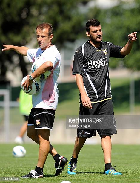 coach assistant Giacomo Murelli and Cesare Bovo of Palermo gesture during a Palermo training session at Sport Well Center on July 4 2011 in Malles...