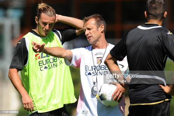 coach assistant Giacomo Murelli gestures as Federico Balzaretti of Palermo looks on during a Palermo training session at Sport Well Center on July 4...