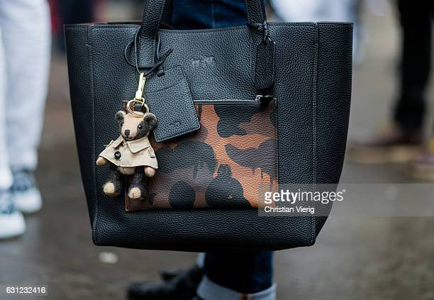 Coach bag with a teddy bear during London Fashion Week Men's January 2017 collections at on January 8, 2017 in London, England.